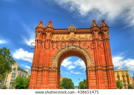 Colorful HDR image of the Arc de Triomf in Barcelona, Spain on a partially cloudy spring day  - stock photo