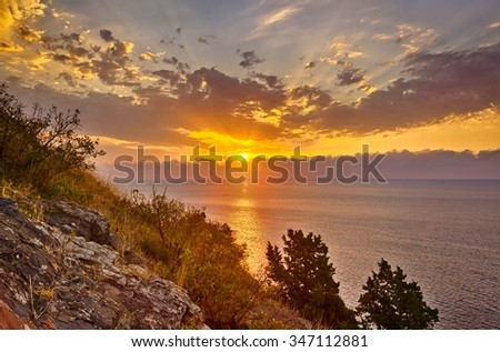 Colorful HDR landscape. Beautiful sunrise at Black sea coast, Crimea. Image made from four photos with different exposure - stock photo
