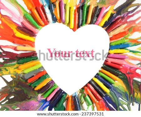 colorful heart circle made out of melted crayons          - stock photo