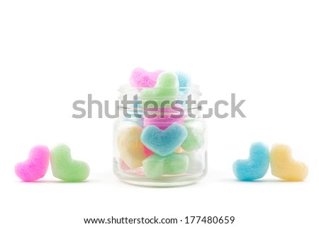 colorful hearts in jar and two pair of heart - stock photo