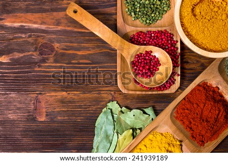 Colorful herbs,spices and aromatic ingredients  on wooden table. - stock photo