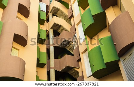 Colorful high rise building facade with curved  lines