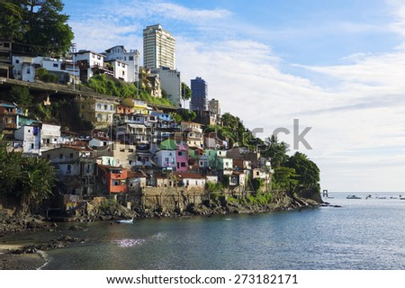 Colorful hillside favela architecture of the Solar do Unhao community overlooking the Bay of All Saints in Salvador Bahia Brazil - stock photo