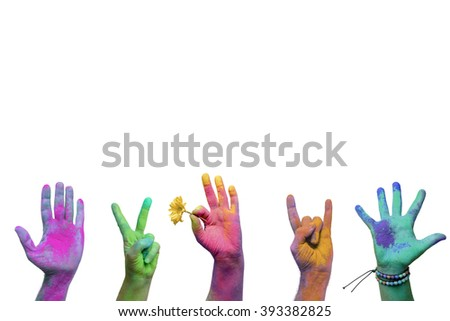 Colorful holi painted hands in different positions - stock photo