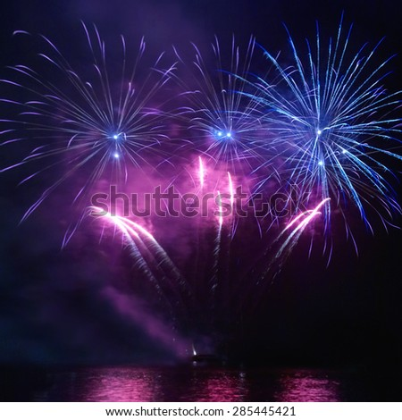 Colorful holiday fireworks on the black sky background - stock photo