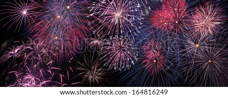 Colorful holiday fireworks panoramic view - stock photo