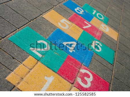colorful hopscotch game on a schoolyard - stock photo