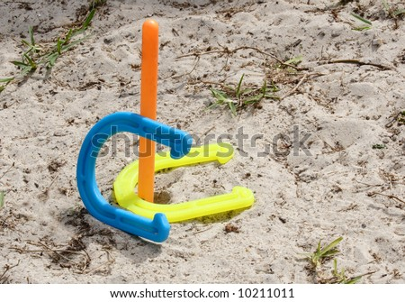 colorful horseshoes in a scoring display - stock photo