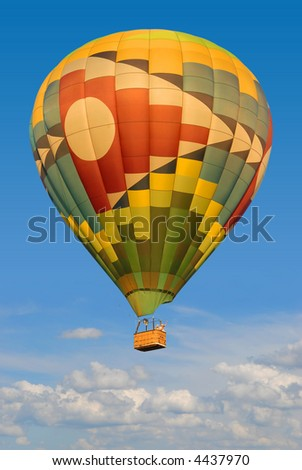 colorful hot air balloon above the clouds with clear blue sky background - stock photo