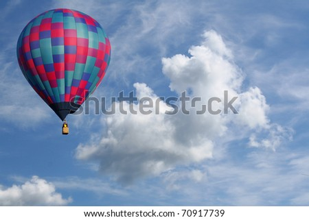 Colorful Hot Air Balloon in a Cloudy Sky - stock photo