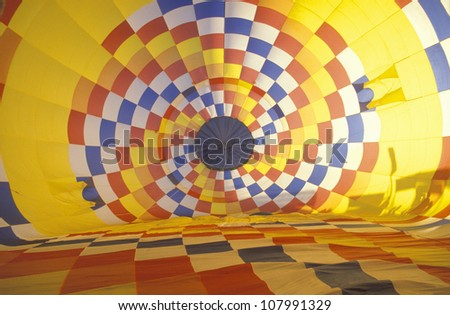 Colorful hot air balloon inflating - stock photo