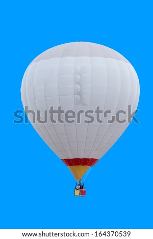 Colorful hot air balloon isolated on blue background - stock photo