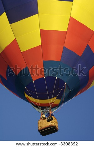 Colorful Hot Air Balloon Lifting Off - stock photo