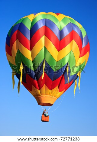 colorful hot air balloon on blue sky - stock photo