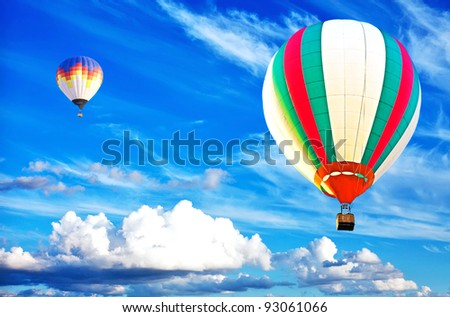 colorful hot air balloon on nice cloudy blue sky - stock photo