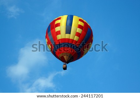 Colorful hot air balloon on the blue sky - stock photo