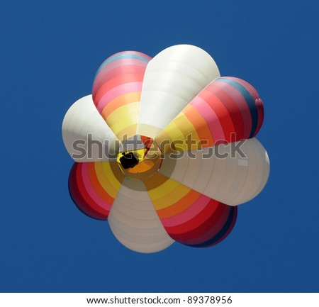 Colorful hot air balloon seen from below - stock photo