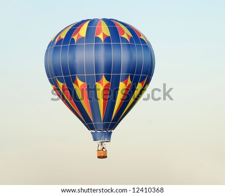 Colorful hot air balloon taking off at dawn