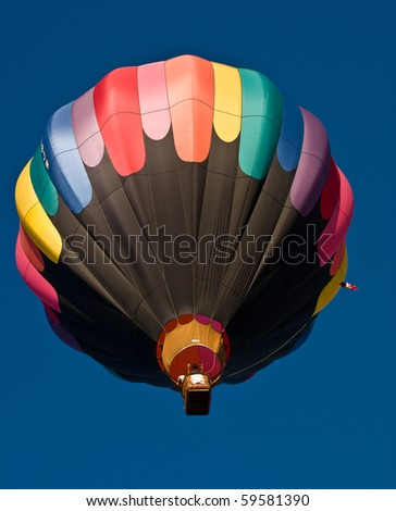 Colorful hot air balloon traveling to the sky - stock photo