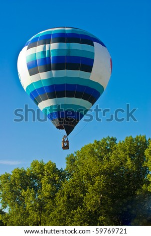Colorful hot air balloon traveling to the sky
