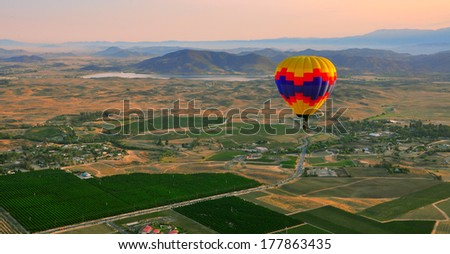 Colorful hot air balloons at sunrise  - stock photo