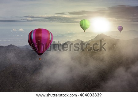 Colorful hot air balloons high in the sky and clouds - stock photo