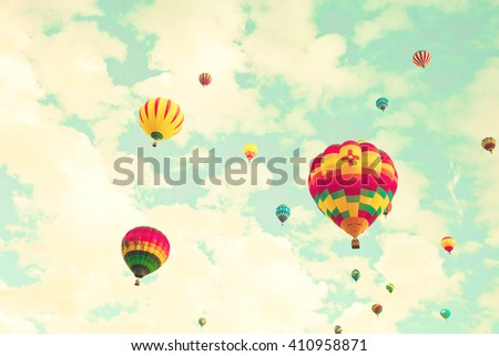 Colorful hot air balloons in a green mint summer sky  - stock photo