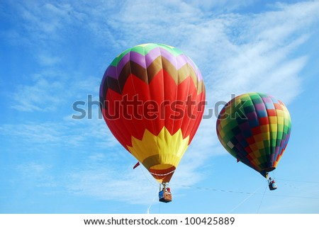 Colorful Hot Air Balloons in Flight - stock photo