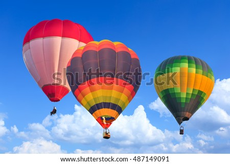 Colorful Hot Air Balloons in Flight over blue sky