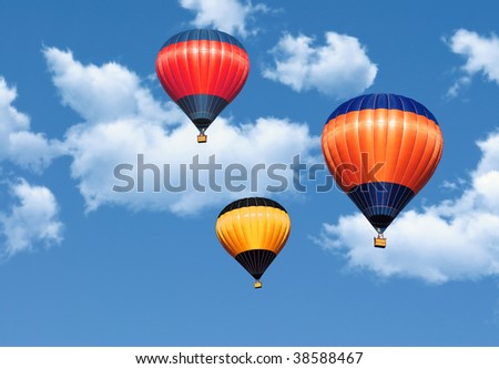 Colorful hot air balloons in the blue sky covered by clouds - stock photo