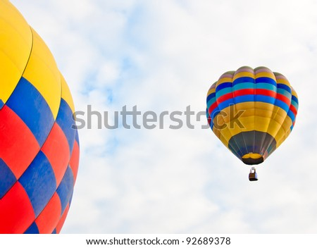 colorful hot air balloons on sky background - stock photo