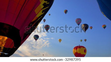 colorful hot air balloons race wide aspect ratio - stock photo