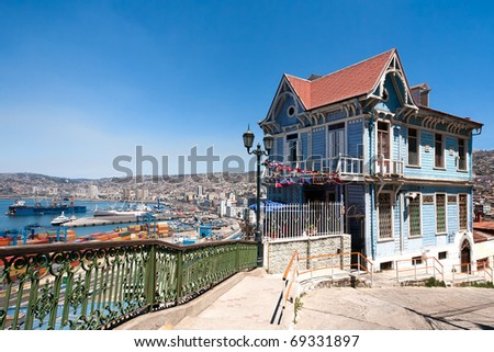 Colorful house in Valparaiso, Chile with view on the port. UNESCO World Heritage. - stock photo