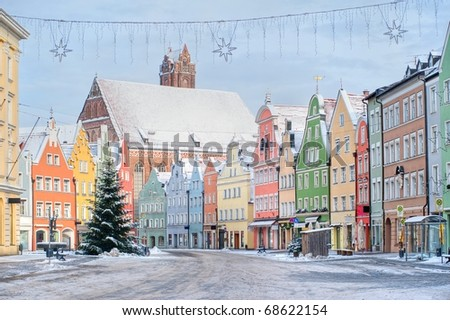 Colorful house line in old bavarian town near Munich in winter - stock photo