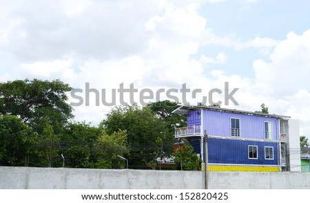 Colorful house on blue sky background.