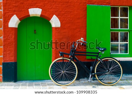 Colorful house with a bike near the entrance - stock photo