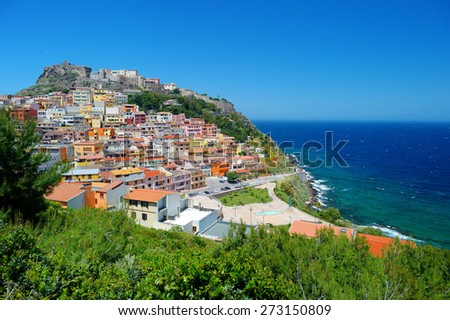 Colorful houses and a castle of Castelsardo town in Sardinia - stock photo