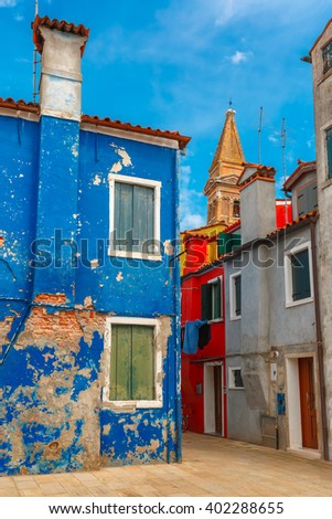 Colorful houses and church on the famous island Burano, Venice, Italy - stock photo