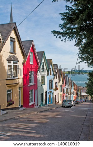 colorful houses called deck of cards in Cobh, Ireland - stock photo