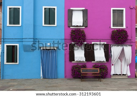 Colorful houses from Burano, a small island of the venetian lagoon. Italy. Taken on August 21, 2015 - stock photo