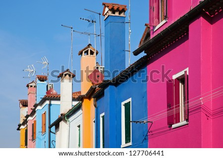 colorful houses in a row on the Venetian island Burano - stock photo