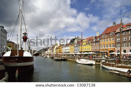 Colorful houses in Copenhagen with a boat - stock photo