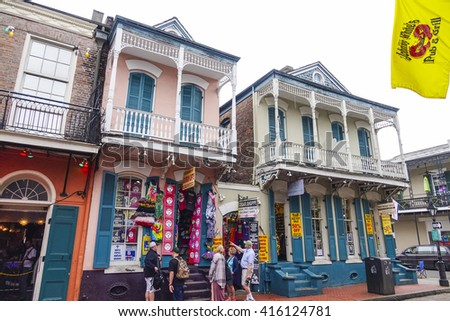 Colorful houses in New Orleans French Quarter - NEW ORLEANS, LOUISIANA - APRIL 18, 2016  - stock photo