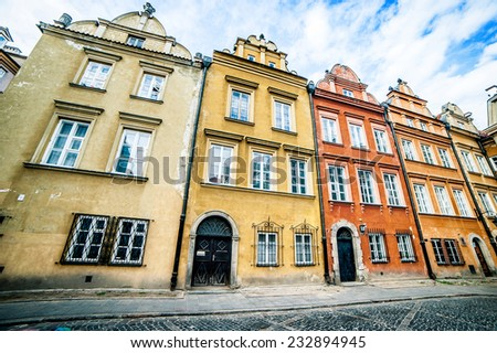 colorful houses in the historic center of Warsaw, near the Castle Square - stock photo