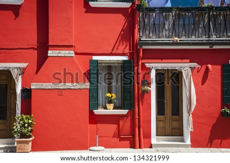 Colorful houses in the island village of Burano, Italy - stock photo