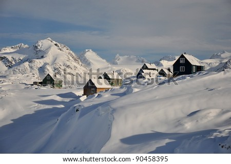 Colorful houses in the Kulusuk village, Greenland - stock photo
