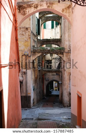 Colorful houses in the small alleys of old town in San Remo, Liguria, Italy - stock photo