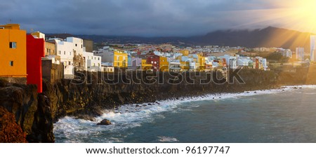 colorful houses on a cliff by the ocean in Puerto de la Cruz - stock photo