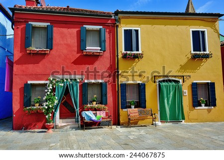 Colorful houses on the famous island Burano, Venice. Venice and the Venetian lagoon are on the UNESCO World Heritage List - stock photo