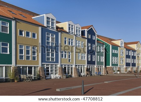 Colorful houses on the harbor quay off Hellevoetsluis, The Netherlands - stock photo